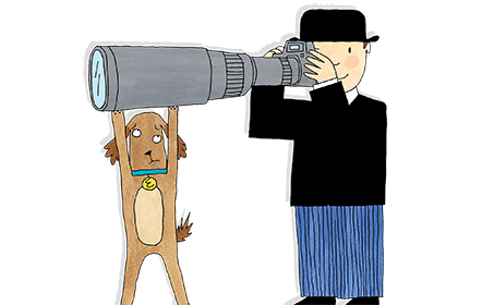 Eddie the brown dog struggles to hold up the huge camera lens as Mr Benn tries to take a photograph