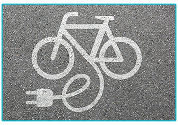 Painted image of E-bike on road.