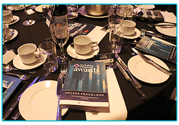 Table at the Yorkshire Financial Awards evening, with programme