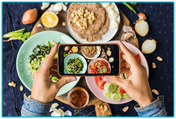 What kind of photographer are you? Taking picture of food on smart phone.