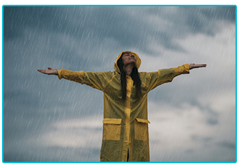 Rainy day activities for your caravan holiday - embracing the rain in a raincoat