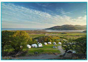 Why are Brits buying more caravans? - picturesque view of a campsite.