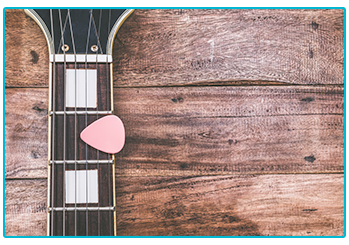 Christmas gift ideas for musicians. Guitar and plectrum.