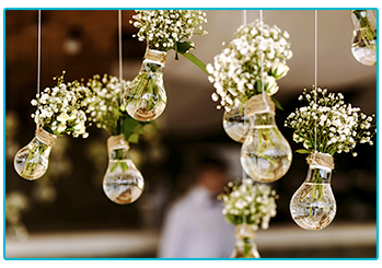 wedding trends - pretty bouquets of flowers suspended in used light bulbs