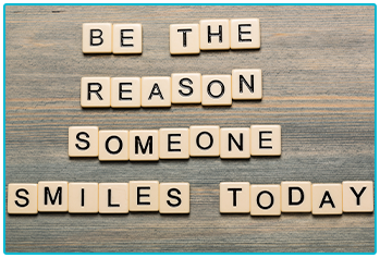 "Random Acts of Kindness Day - Scrabble pieces spell out ""be the reason someone smiles today"""