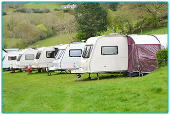 New Touring Caravans - touring caravans in a row on campsite