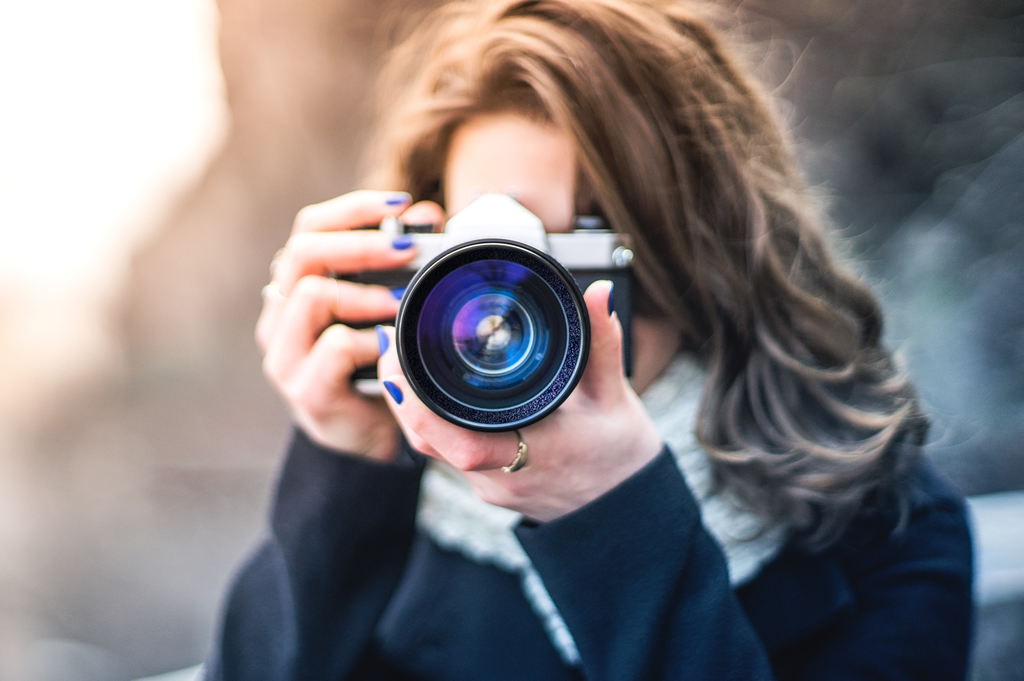 photography news woman taking photo with camera